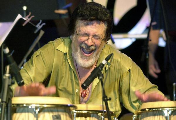 **FILE** Grammy-winning Latin jazz percussionist  Ray Barretto plays the congas at the Tito Puente Auditorium in San Juan, Puerto Rico, in this Aug. 3, 2002 file photo.  Barretto, who had heart bypass surgery last month and had pneumonia, died Friday, Feb. 17, 2006,at Hackensack, N.J., University Medical Center with his wife and two sons by his bedside, said spokesman George Rivera. (AP Photo/Andres Leighton, file)